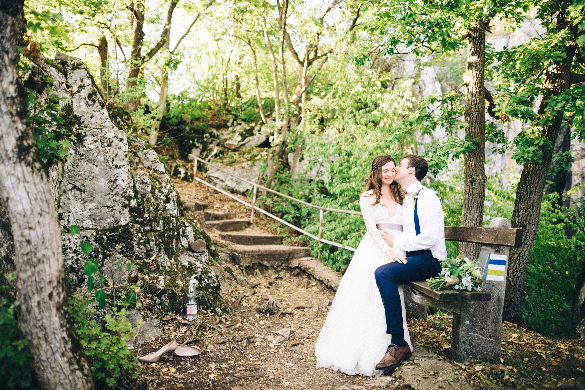40-couple-sitting-on-bench-wedding-portrait