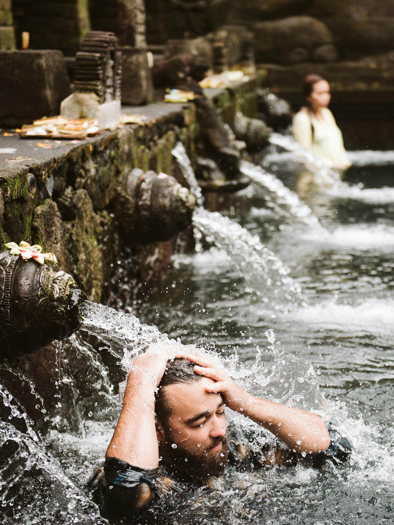 Roky spending his 33rd birthday taking a plunge in Bali's holy water at Tanah Lot Temple