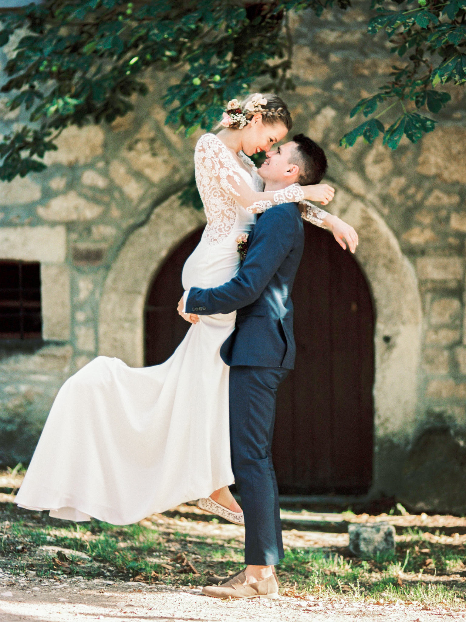 Groom lifting Bride in the air during Vineyard wedding