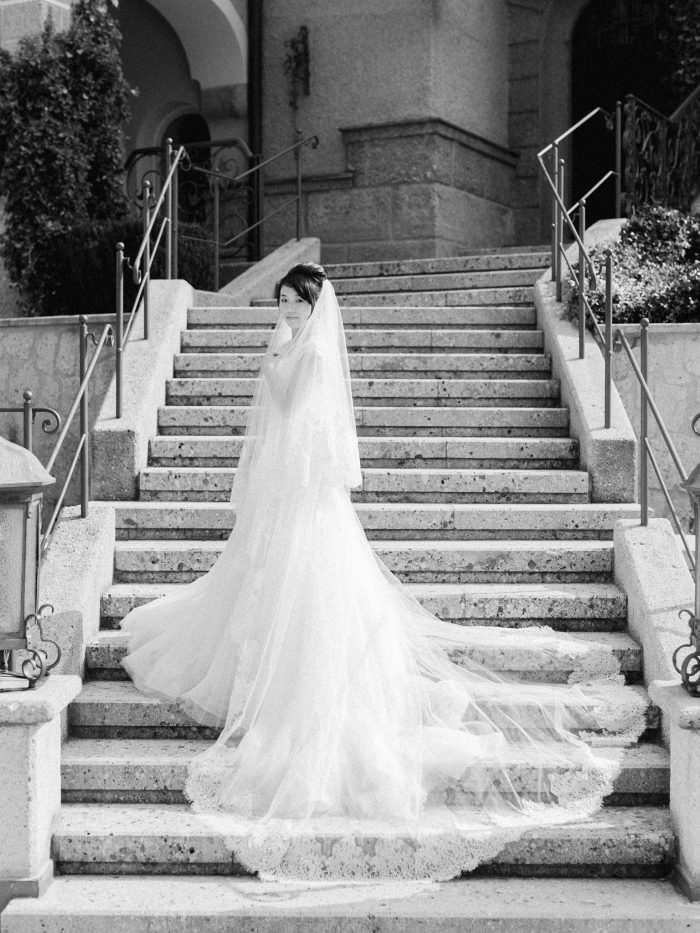 Beautiful bridal gown laid out on the steps